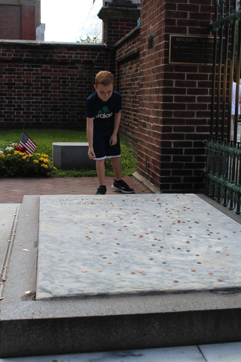 Throwing pennies on Benjamin Franklin's grave for good luck.  I put one on his wife's grave too.